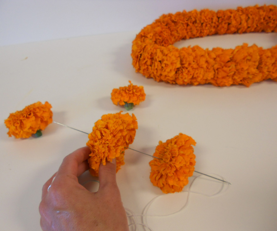 http://mellanoandcompany.files.wordpress.com/2012/10/making-marigold-lei.jpg